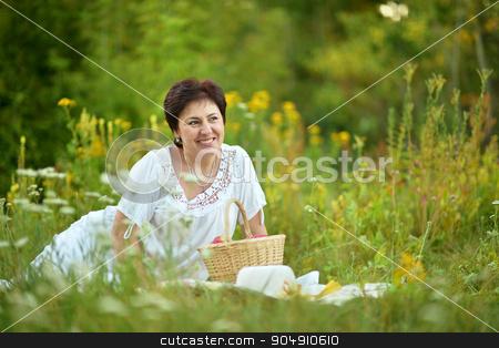 Happy elder woman resting on grass stock photo, Happy elder woman resting on grass at nature by Ruslan Huzau