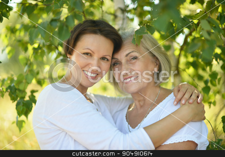 Mother and daughter in  park stock photo, Mother and her nice daughter in  park by Ruslan Huzau