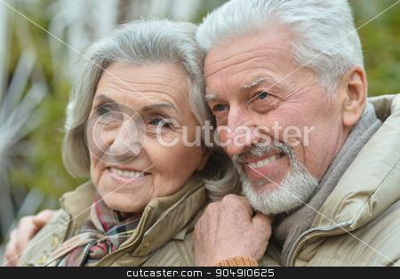 Mature couple walking stock photo, Portrait of a happy nice mature couple walking by Ruslan Huzau