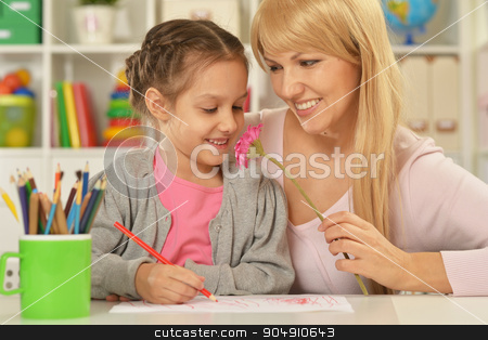 Girl painting with mother stock photo, Portrait of a little girl painting with her mother by Ruslan Huzau