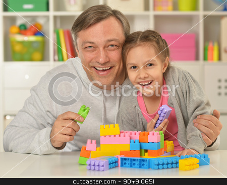 happy father  playing with little daughter stock photo, Portrait of happy father  playing with little daughter at home by Ruslan Huzau