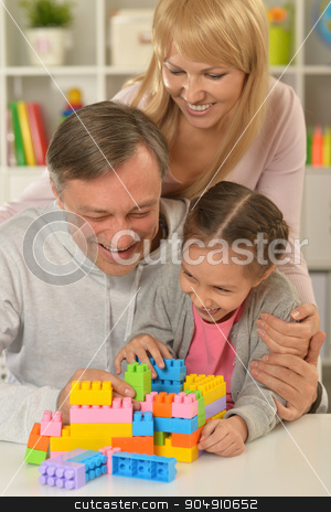 happy family playing at home stock photo, Portrait of happy family playing at home by Ruslan Huzau