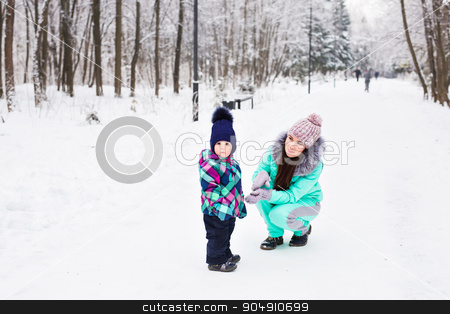 happy family mother and child baby daughter on a winter walk in the woods stock photo, happy family mother and child baby daughter on a winter walk in the woods by Satura86
