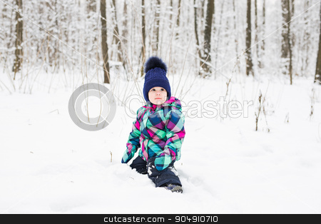 Small girl playing with snow stock photo, Small girl playing with snow. Winter time by Satura86
