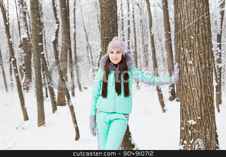Beautiful young girl walking in winter forest stock photo, Beautiful young girl walking in winter forest by Satura86
