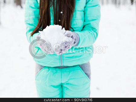 girl holding snow in hands stock photo, Young  girl holding snow in her  hands by Satura86