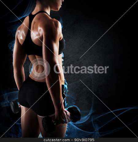 Woman trained stock photo, Muscular woman in shorts and top sports by Federico Caputo