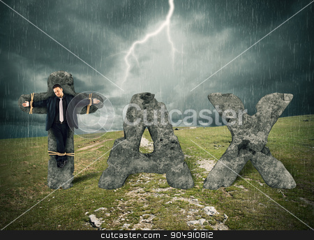 Crucifix by tax stock photo, Crucified man on the stone during storm by Federico Caputo