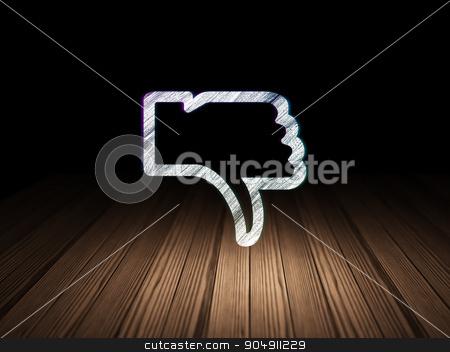 Social media concept: Thumb Down in grunge dark room stock photo, Social media concept: Glowing Thumb Down icon in grunge dark room with Wooden Floor, black background by mkabakov