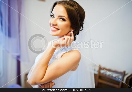 Portrait of smiled cute brunette bride stock photo, Portrait of smiled cute brunette bride by Andrii Shevchuk