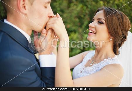 Groom kiss hand of bride stock photo, Groom kiss hand of bride by Andrii Shevchuk