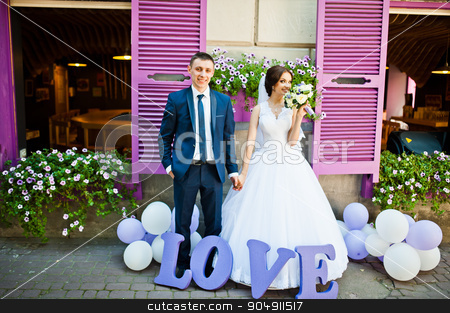 Newlywed with decor violet word love background purple wooden wi stock photo, Newlywed with decor violet word love background purple wooden window by Andrii Shevchuk