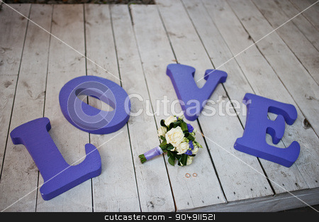Purple decor wedding word love with bouquet and rings stock photo, Purple decor wedding word love with bouquet and rings by Andrii Shevchuk