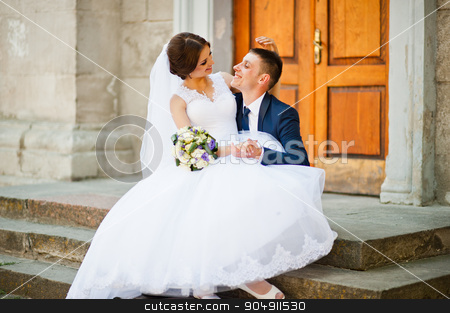 Wedding couple walking on streets of city  stock photo, Wedding couple walking on streets of city  by Andrii Shevchuk