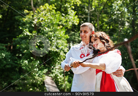 Love story of loving couple in national Ukraine dress.  stock photo, Love story of loving couple in national Ukraine dress.  by Andrii Shevchuk