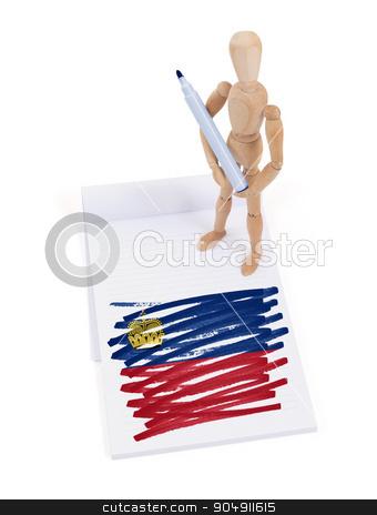 Wooden mannequin made a drawing - Liechtenstein stock photo, Wooden mannequin made a drawing of a flag - Liechtenstein by michaklootwijk
