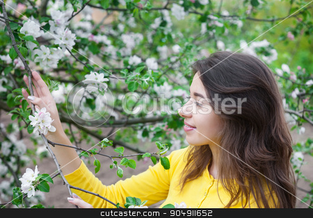beautiful woman near blossoming tree in spring stock photo, beautiful woman near blossoming tree in spring. by timonko
