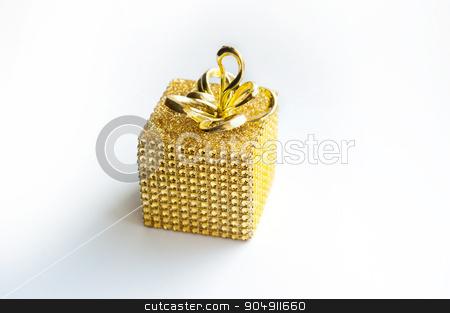 Golden gift box with golden ribbon over white background stock photo, Golden gift box with golden ribbon over white background. by timonko