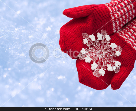 woman hands in red gloves holding white big snowflake stock photo, woman hands in red gloves holding white big snowflake. by timonko