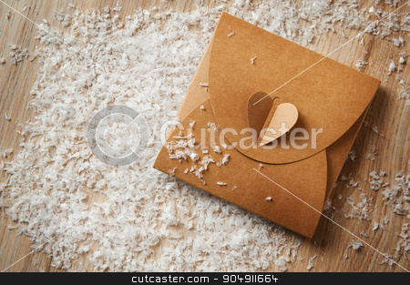 Gift box wrapped in kraft paper with ribbon bow stock photo, Gift box wrapped in kraft paper with ribbon bow. by timonko