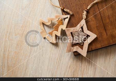 photobook in a wooden cover and wooden toys stock photo, photobook in a wooden cover and wooden toys. by timonko