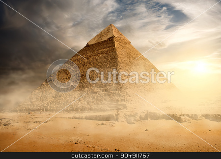 Pyramid in sand dust stock photo, Pyramid in sand dust under gray clouds by Givaga