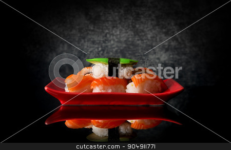 Sushi on red plate stock photo, Sushi on a red plate and black background by Givaga