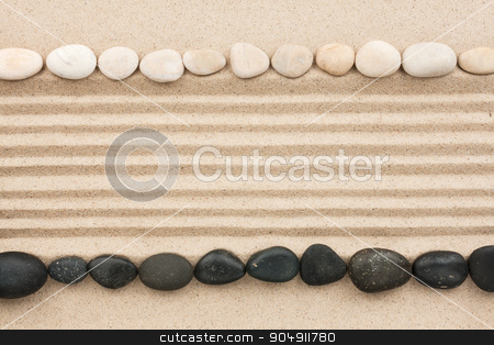 Black and white stones on sand stock photo, Black and white stones on sand, with space for text by alekleks