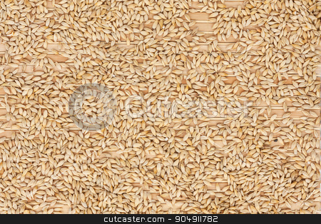 Background of barley  lying on a bamboo mat stock photo, Background of barley  lying on a bamboo mat, how the texture by alekleks