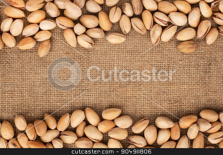 Stitching and sewing pistachios lying on sackcloth  stock photo, Stitching and sewing pistachios lying on sackcloth can use as background by alekleks