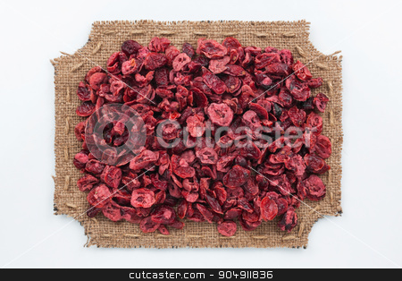 Figured frame made of burlap with dried cranberry stock photo, Figured frame made of burlap with dried cranberry, on a white background by alekleks