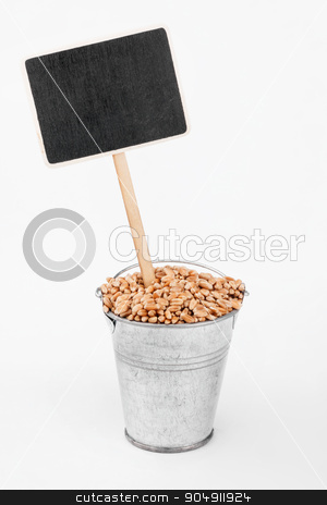 Pointer, price in bucket of  wheat grains stock photo, Pointer, price in bucket of  wheat grains, on a white background by alekleks