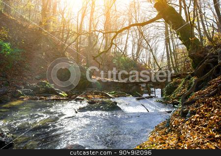 Mountain river and bridge stock photo, Wooden bridge and mountain river in autumn by Givaga