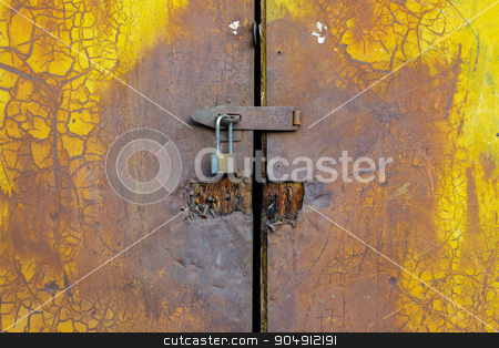 Background of door with lock in metal material  stock photo, Background of door with lock in metal material and copyspace on wall. by kkolosov