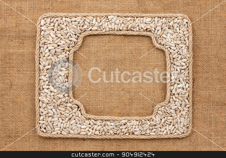 Two frames made of rope with sunflower seeds on sackcloth stock photo, Two frames made of rope with sunflower seeds on sackcloth, as background, texture  by alekleks