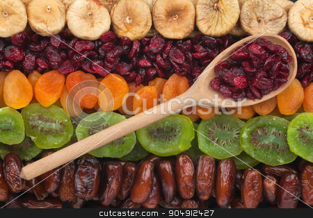 Wooden spoon with cranberries  stock photo, Wooden spoon with cranberries lies on the dried fruit by alekleks