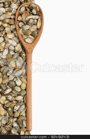 wooden spoon with pumpkin seeds stock photo, wooden spoon with pumpkin seeds,Isolated on white background by alekleks