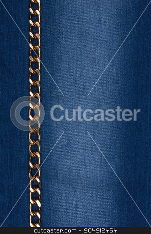 Gold chain lying on denim stock photo, Gold chain lying on denim, can be used as background. by alekleks