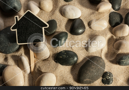 Close-up of stones and house sticking out of the sand in the sun stock photo, Close-up of stones and house sticking out of the sand in the sunlight, with place for your text  by alekleks