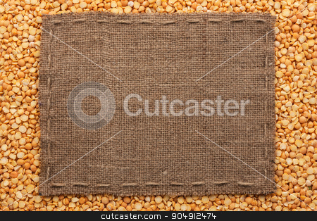 Frame made of burlap with the line lies on  peas seeds stock photo, Frame made of burlap with the line lies on  peas seeds, with place for your text by alekleks