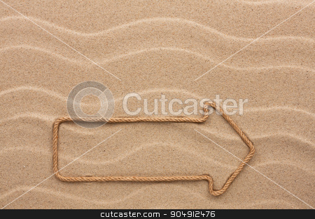 Pointer made of rope on the sand stock photo, Pointer made of rope on the sand, with place for your text by alekleks