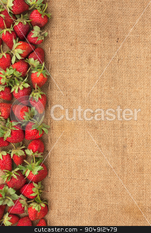 Strawberries lies on sackcloth stock photo, Strawberries lies on sackcloth, can be used as background by alekleks