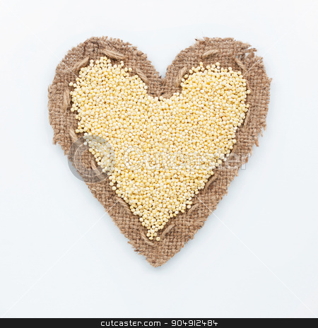 Frame in the shape of heart with millet stock photo, Frame in the shape of heart with millet, on a white background by alekleks