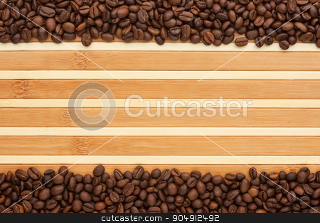 Coffee beans lying on a bamboo mat stock photo, Coffee beans lying on a bamboo mat, place for your text by alekleks