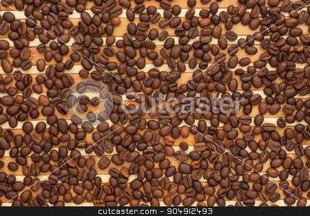 Coffee beans lying on a bamboo mat stock photo, Coffee beans lying on a bamboo mat, can be used as a background by alekleks