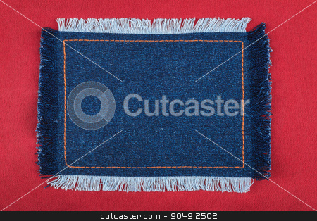 Frame made of denim fabric with yellow stitching on red silk stock photo, Frame made of denim fabric with yellow stitching on red silk, with space for your text by alekleks