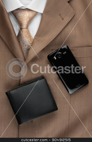 Purse and phone lying on the suit and tie stock photo, Purse and phone lying on the suit and tie, can be used as background by alekleks