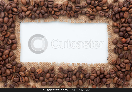 Frame of burlap and coffee beans lying on a white background stock photo, Frame of burlap and coffee beans lying on a white background,can be used as texture by alekleks