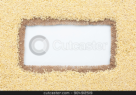 Frame made of burlap with millet stock photo, Frame made of burlap with millet, on a white background by alekleks