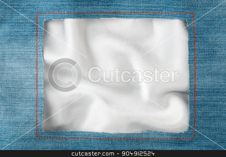 Frame made of denim fabric with yellow stitching on white silk stock photo, Frame made of denim fabric with yellow stitching on white silk, with space for your text by alekleks